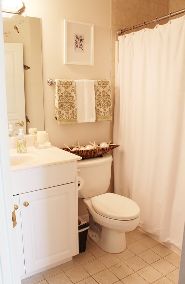 See how I decorated my bathroom to give it a spa like look! Wall art, shower curtain, and decorative towel ideas. www.settingforfour.com