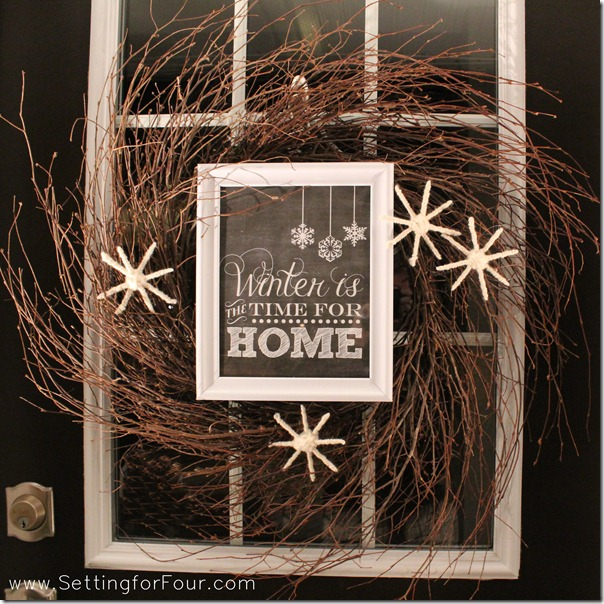 DIY WInter wreath tutorial with chalkboard printable and fluffy white yarn snowflakes.
