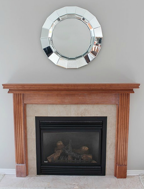 WOW! See this STUNNING fireplace mantel reveal! Learn how to paint a wood mantel in 3 easy steps! DIY tutorial and supply list included.