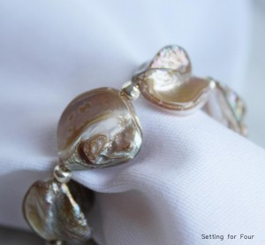 Add some coastal style to your life with these pretty DIY shell napkin rings!