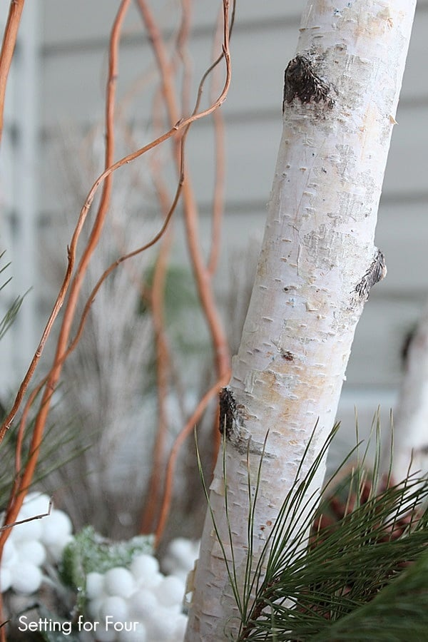 Birch branches decorate an urn srcset=