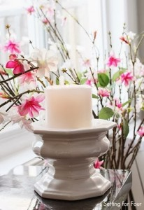 Candle Vignette with pink cherry blossom branches in vase