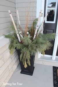 Urn decor with curly willow, fresh pine, birch branches and large pinecones