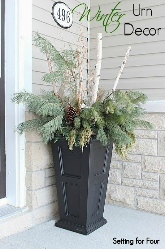 See how I made these beautiful festive DIY holiday urns with birch and pine for my entryway! Great Christmas container decorating tips to improve the curb appeal of your home! www.settingforfour.com