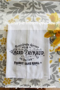 Love French Decor? Make this Easy DIY Sharpie French Label Towel with a Vintage French Advertisement Label Pattern. Beautiful way to decorate your French Farmhouse kitchen! Great gift idea too!