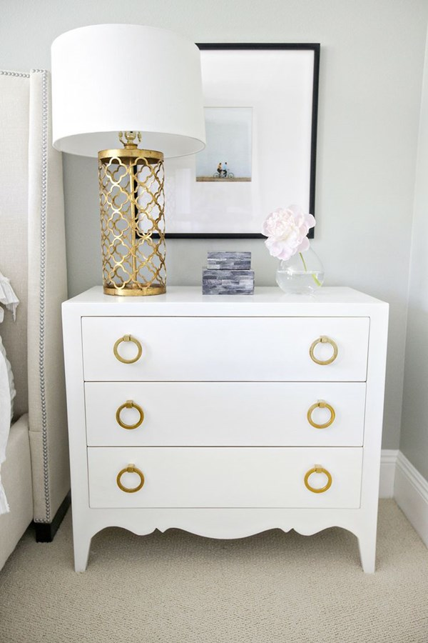 Decor inspiration - white dresser with gold pulls paired with a gold cutwork lamp is a stunning!