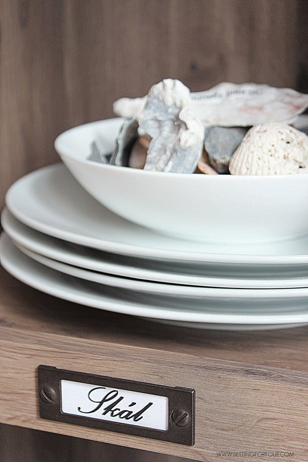 DIY tip: How to add labels to a kitchen bookcase that say 'Cheers' in other languages!