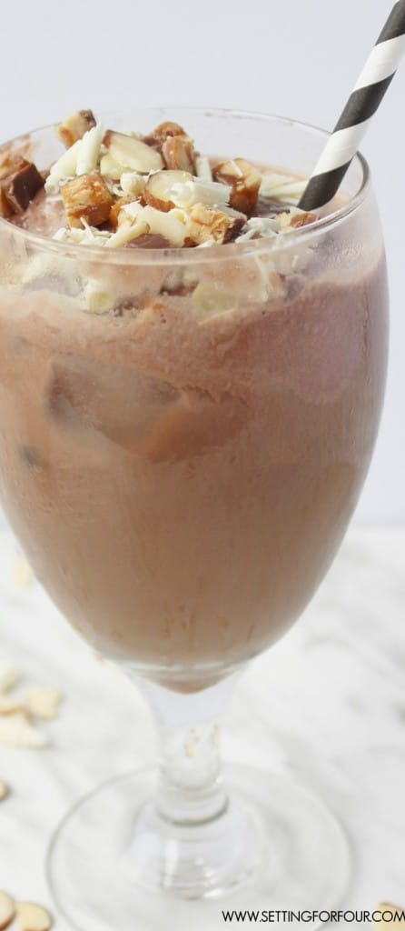 So DELICIOUS!!! If you love chocolate bars, mocha and iced coffee flavors you'll love this drink! Get this sweet tooth satisfying, cold drink recipe for Mocha Iced Coffee Float with White Chocolate Curls and Snickers Crunch Topping!