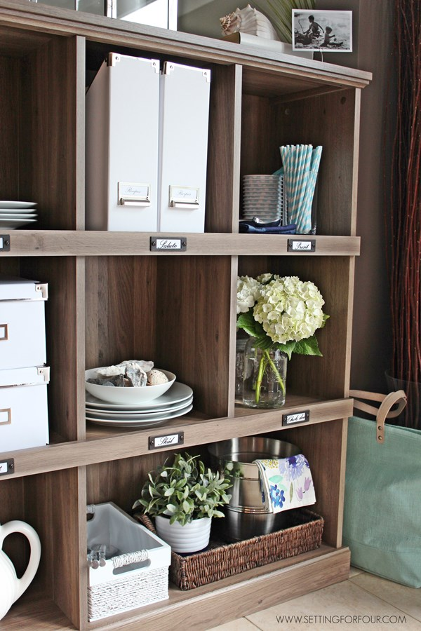 Add storage and organization to your kitchen with a bookcase! | www.settingforfour.com
