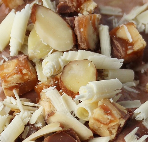 How to make White Chocolate Curls and Snickers Crunch Topping garnish for dessert recipes and drinks!