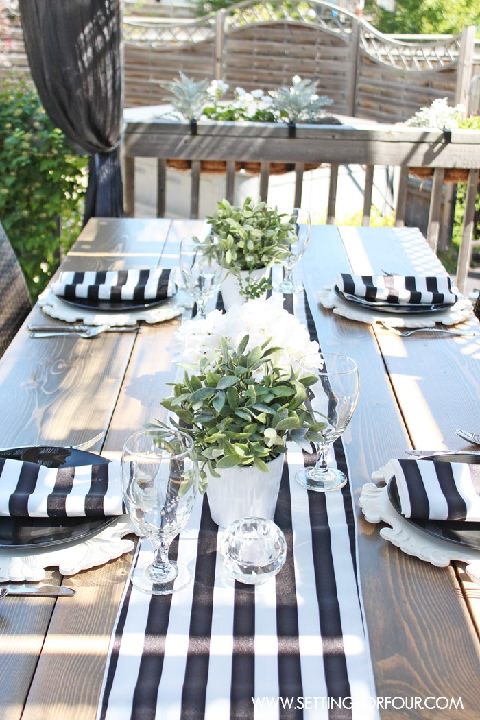 See how to create a beautiful black and white tablescape - al fresco style! - using stylish awning stripe table linens plus simple centerpiece ideas.