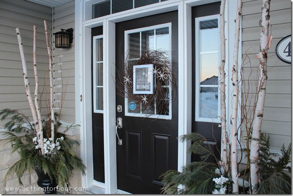 How to decorate a winter front porch with winter urns and a DIY winter wreath. Decor resource list, DIY Tutorial and supply list included.