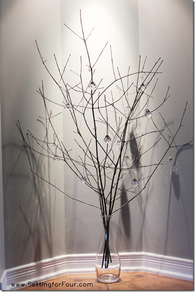 Sparkly Branch Centerpiece twinkles at night from Setting for Four #centerpiece #branch #decor #winter