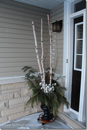 Decorate the outside of your home for winter with DIY urns filled with fresh pine, curly willow and artificial berries and pine poles. See mine on my front porch!