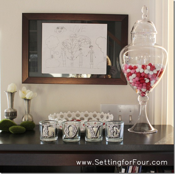 DIY Pottery Barn Inspired Valentine's Candle Votives from Setting for Four. See the tutorial here: https://www.settingforfour.com/2012/01/love-votive-candle-set.html #diy #modpodge #candle #craft #valentine