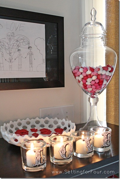 DIY Pottery Barn Inspired Valentine's Day Votives from Setting for Four. See the tutorial here: https://www.settingforfour.com/2012/01/love-votive-candle-set.html #diy #craft #modpodge #valentine #candle