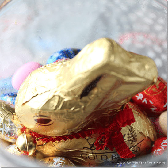 Add chocolates to jar - Steps to make Easter in a Jar - Setting for Four #diy #easte #gift