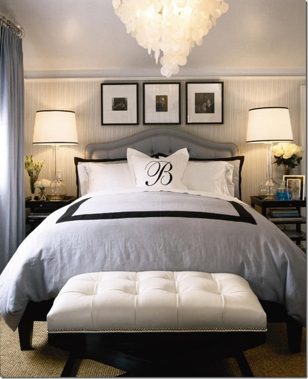 Capiz candelier and tufted headboard are the focal points of this gorgeous bedroom!