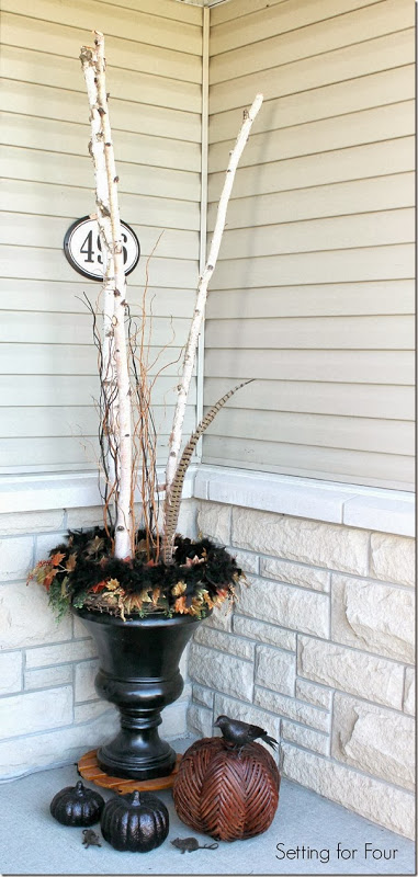 Birch filled urns and pumpkin decor - see all five porch decor ideas for fall and Halloween!