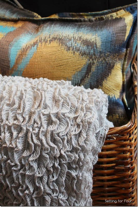 Decorate your home the easy way with a Basket of pillows and a throw.