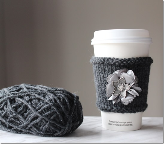 Learn how to make this QUICK AND EASY DIY Cashmere Cup Cozy! I added a pretty fabric flower accent to it. See the knitting tutorial and supply list to make this fun mug cozy craft. Great gift idea!