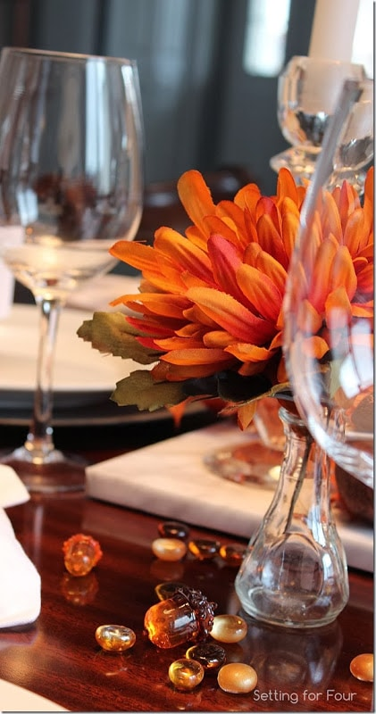 Orange mums and table gems