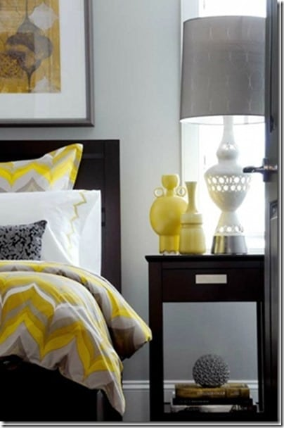 Pops of yellow mixed with white and grey create a stylish bedroom!