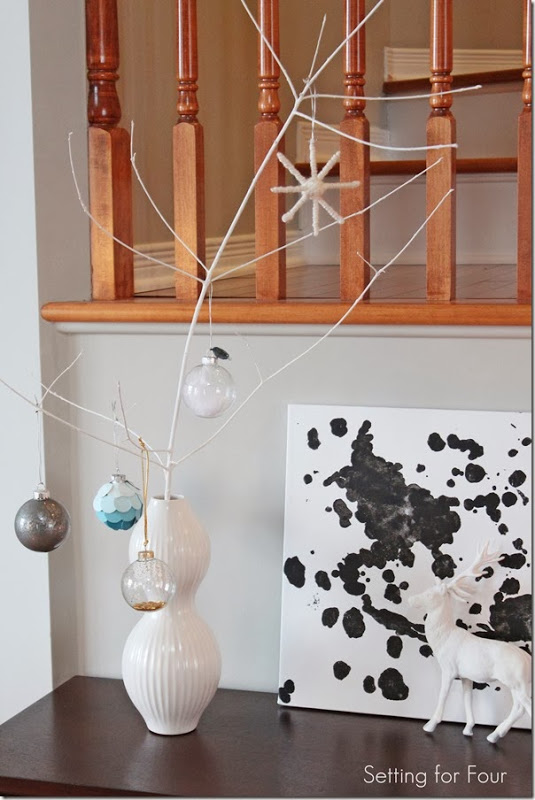 White branch with holiday decorations