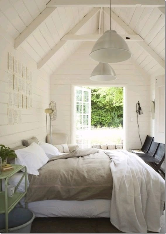 Light and Bright Bedroom with linen duvet cover and white pannelled walls.