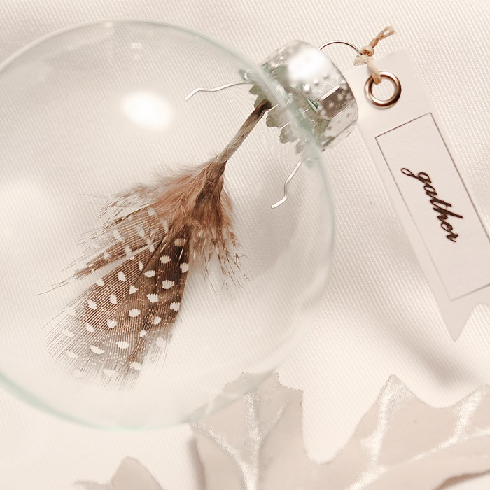 Make these easy DIY Feather Place Card Ornaments for your tablescapes or Christmas tree decor! | www.settingforfour.com