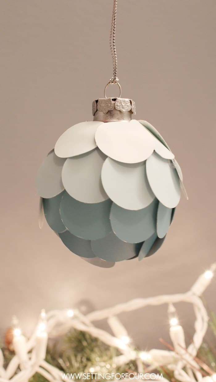Make this Easy Stylish DIY Ombre Paint Chip Ornament! What a great way to use leftover paint chips you've collected! Choose paint chip colors that coordinate with the colors in your home and with your seasonal decor. Great gift idea and present topper too!