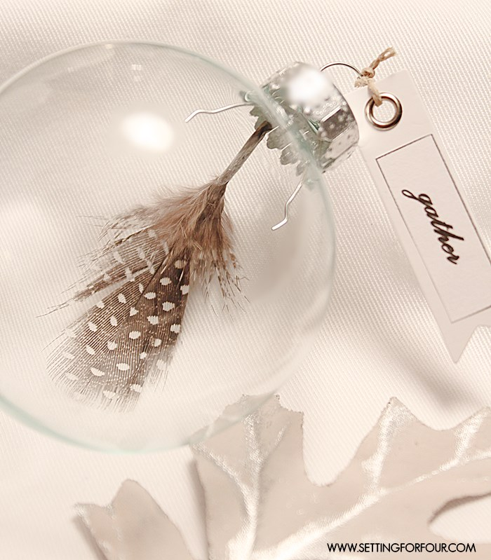 Make these DIY Feather Place Card Holders, they're so easy to whip up - great gift idea or gift topper! | www.settingforfour.com