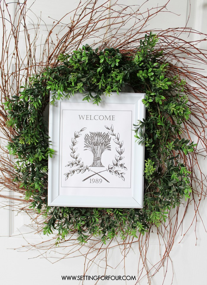 Make and hang this on your front door! DIY Boxwood Wreath with Welcome Printable - easy and budget friendly! www.settingforfour.com