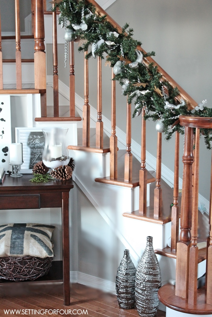 Christmas home tour setting for four for Stair railing decorated for christmas