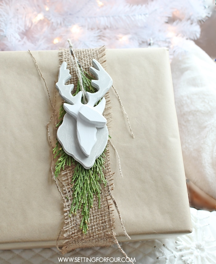 DIY Deer Ornament with a Scandinavian look! Hang it on a Christmas tree or use it as a holiday present topper when wrapping gifts!