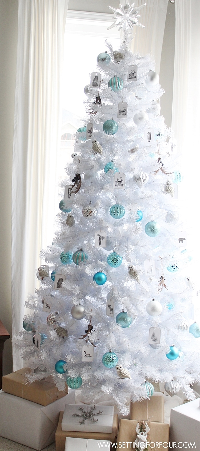See how I decorated my Winter Woodland Glam White Christmas Tree for the holidays! DIY decor with woodland animals, metallics and shine! www.settingforfour.com