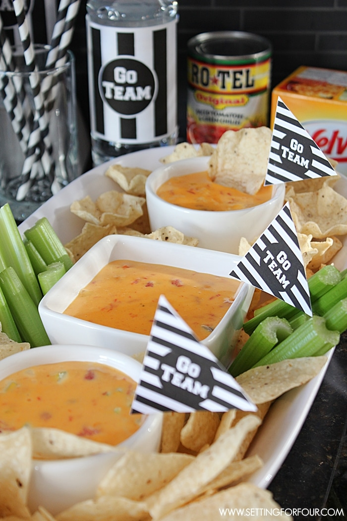 Throw the perfect festive Superbowl party or Football party with this yummy, zesty Queso Dip Recipe! Perfect appetizer snack for movie nights too. www.settingforfour.com