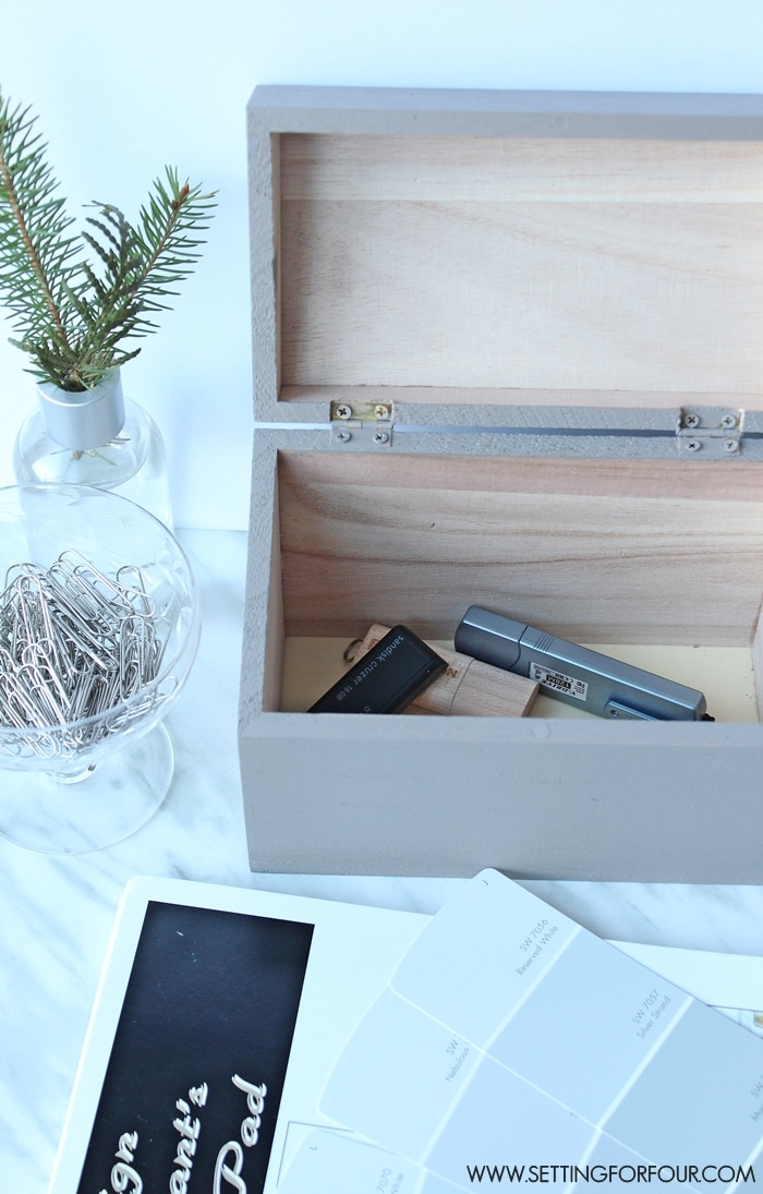 Organizing your desk top to declutter your home office and work space? A decorative painted storage box keeps home office supplies within easy reach and organized.