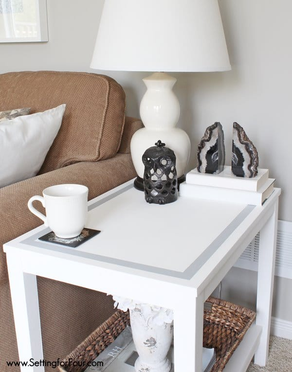 Update your decor easily! DIY chalk painted table with a gray strip border - see how I gave this dreary, damaged fake-wood table a makeover!