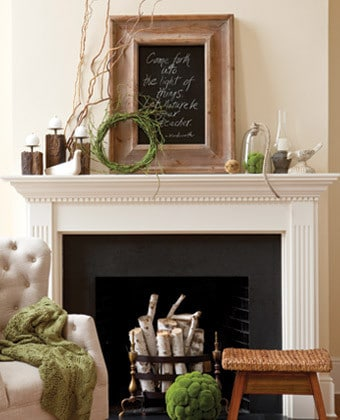 Natural Spring mantel decor- bright mossy green accents absolutely pop off of the neutral backdrop! This mantel is all about texture and layers with a casual relaxed style.