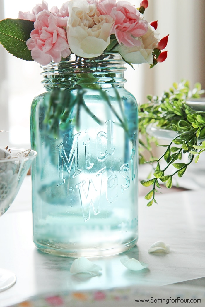 Such a clever DIY tip! This is the quickest, easiest way (ever!) to tint mason jars blue - no messy painting required! I can't believe how quick it is to get that perfect vintage blue mason jar color! www.settingforfour.com