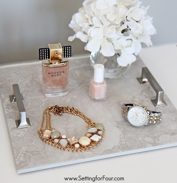 A stylish DIY tray made from repurposed cabinet hardware and gorgeous gray marbled floor tile!