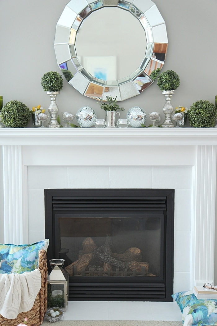 How to Decorate a Spring Mantel with Style  See my mantel filled with  pretty Spring. Spring Mantel Decorating Ideas   Setting for Four