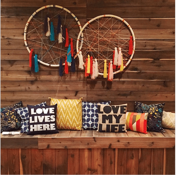 Oversized DIY Hula Hoop Dream Catcher with tassels wall art idea.