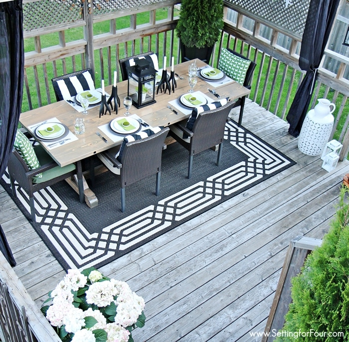 Summer Deck Decorating ideas - see how I decorated our deck 'Summer Lodge' Style with a color palette of black, white and green! www.settingforfour.com