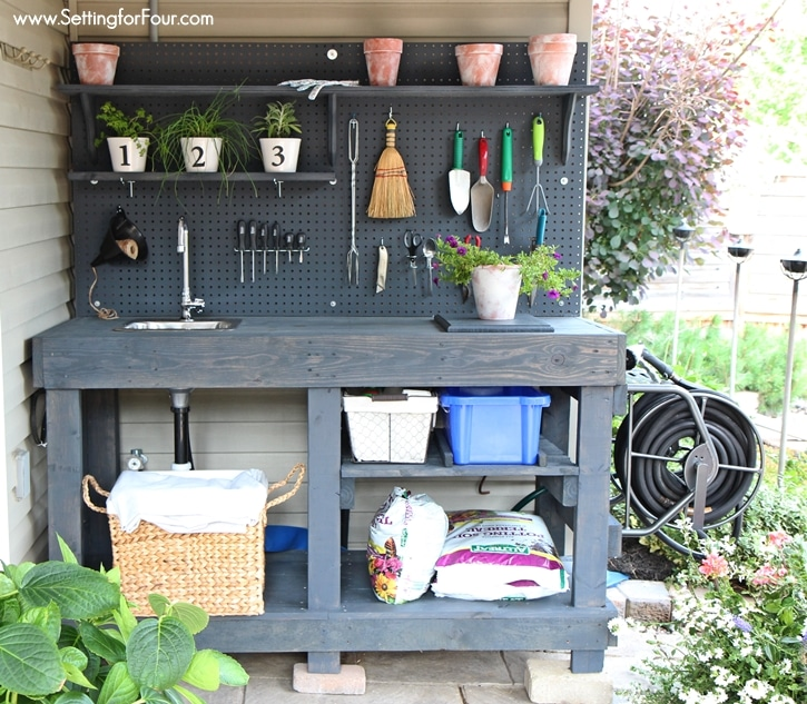 Organize all of your gardening tools, supplies and containers with this DIY pallet potting bench made from free pallet wood! Pot flowers, plants and herbs easily. www.settingforfour.com