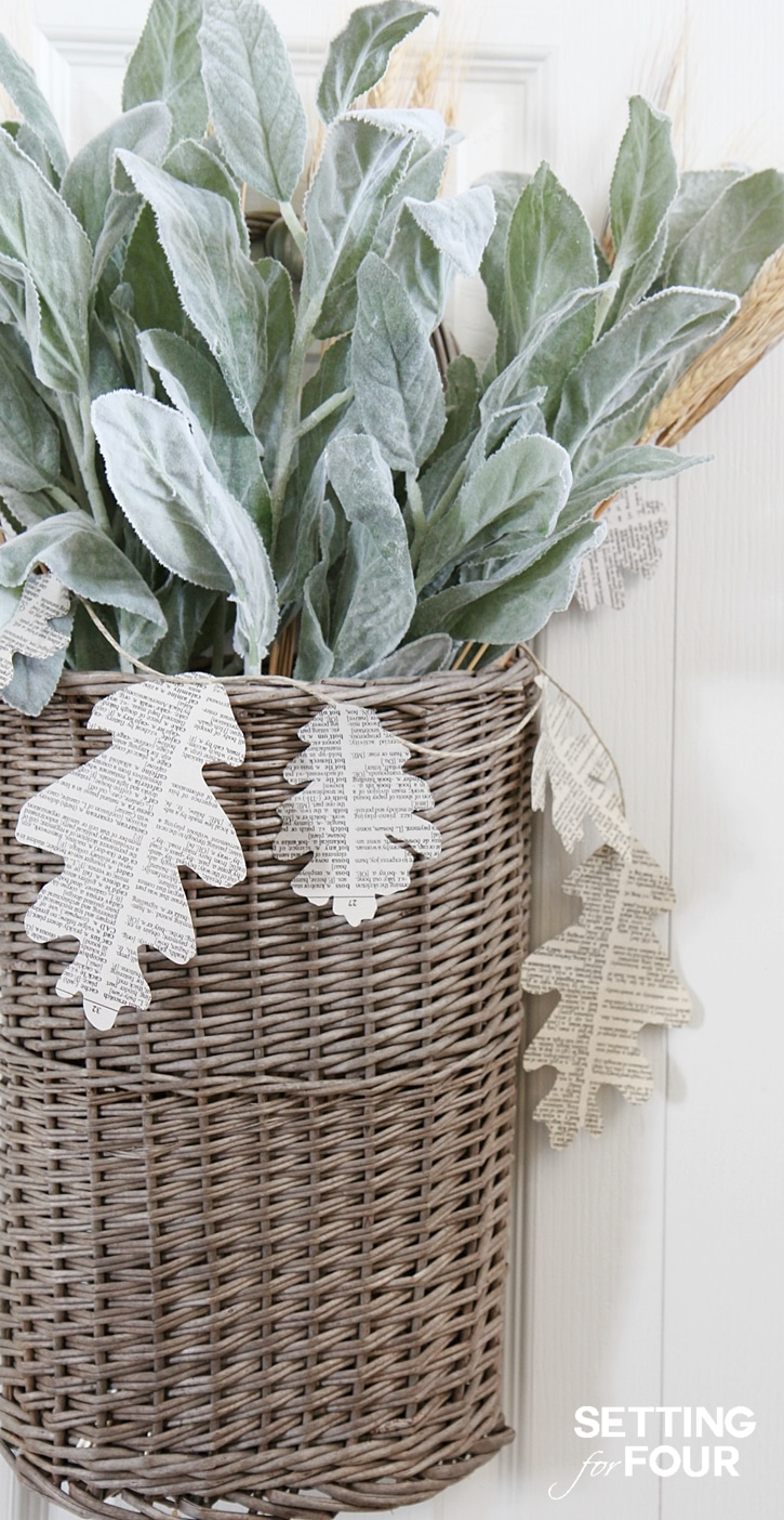 Easy DIY Fall Wreath Basket Decorating Idea - see the tutorial on how to make it with faux lambs ears and a DIY book page garland! Add it to your front door or decorate an empty corner of your home for autumn.