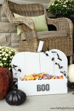 Make this beautiful DIY wood pumpkin for your front porch! DIY tutorial included. Use it to hold candy, little pumpkins or plants!