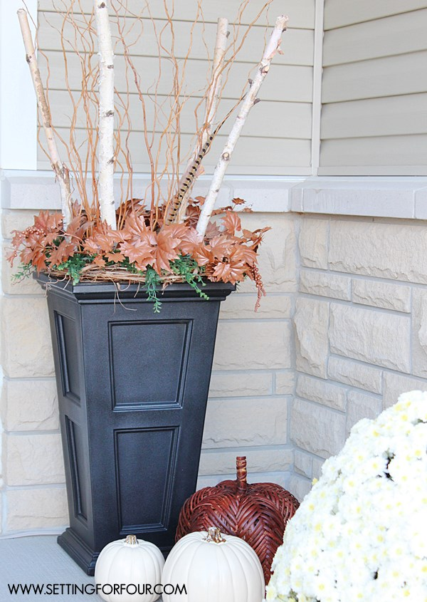 Add curb appeal to your home with these pretty Fall entryway decor and fall urn ideas. www.settingforfour.com