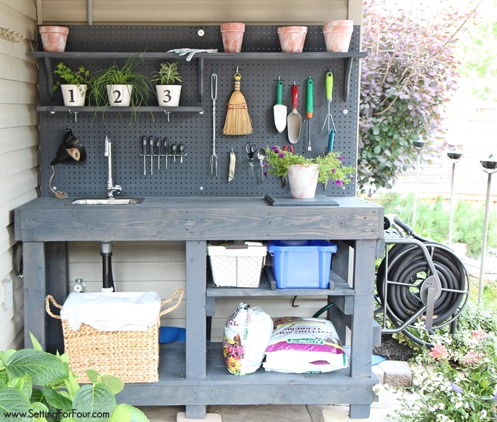Attention gardeners! How to make a gorgeous DIY Potting Bench from FREE pallet wood! Has ALL the bells and whistles: a faucet, sink, running water, mounted hose reel, shelves, tool storage, pegboard and more! Free building tutorial, instructions and supply list included. www.settingforfour.com